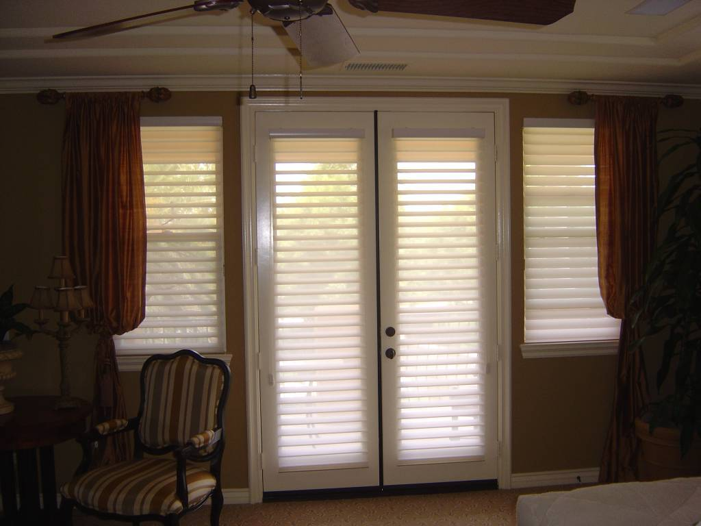 silhouette shades on french doors combined with drapery treatments